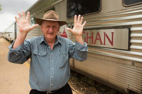 Special guest and former Australian polititian Tim Fischer celebrates as he shows the number 10 in Alice Springs during The Ghan 10th anniversary trip from Adelaide to Darwin.